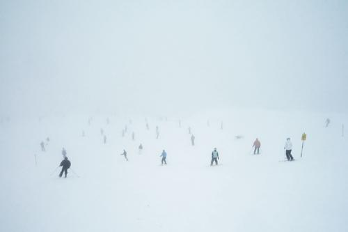 White Winter Cold Snow Fog Many Skiing Muddled Crowd of people Narrow Downward Full Slope Skier Bad weather Winter sports