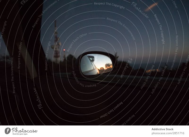 Car rearview mirror Mirror Rear view Vantage point Side rear-view Stern Twilight Exterior shot Transport Vehicle Window Day Glass Reflection Safety Part