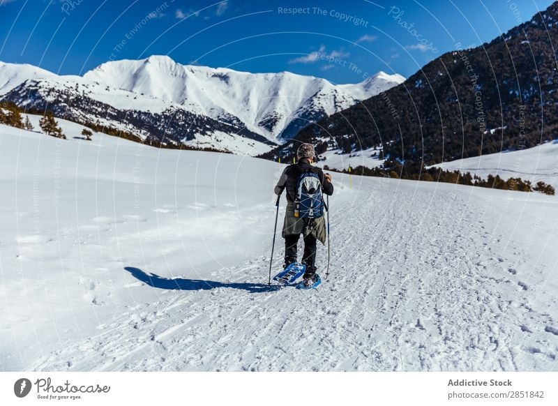 Man walking through the snow Snow Hiking Walking trekking White Winter Snow shoes Nature Lifestyle Mountain Action Cold Sky Climbing 2 Backpack snowshoe