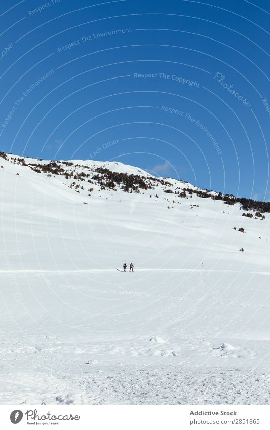 People walking through the snow Snow Mountain Winter Human being Snow shoes Nature Ski resort White hiker Landscape Adventure Man Woman Sports Hiking Sky Cold