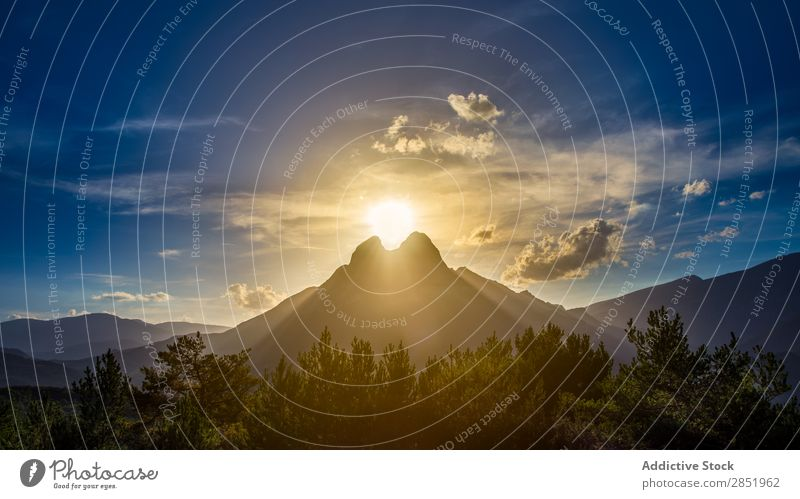 Sunset with the sun between two mountains Mountain Dawn Between Spain Landscape Catalonia pedraforca Nature Background picture Sky Clouds Blue Natural