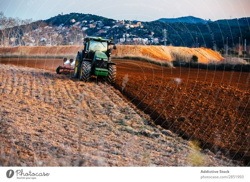 Tractor plowing the field Plow Field Earth Farm Landscape Agriculture agricultural Landing Cultivation Equipment Brown machine Machinery Scene Rural Vehicle