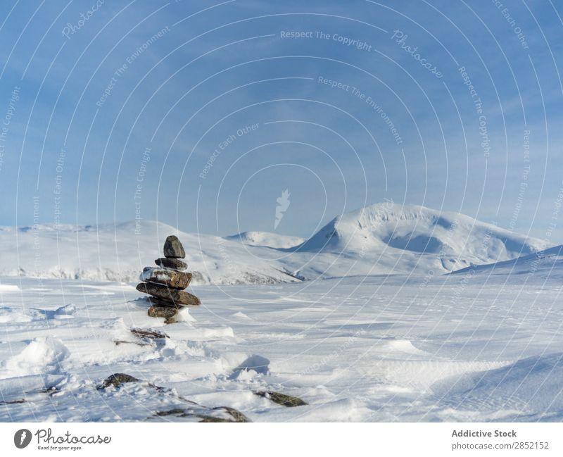Stacked stones in winter Stone Tower Hill Snow Nature Zen Relaxation Landscape Winter Cold Ice Blue Frost White Beautiful Fresh Weather Mountain Calm Day