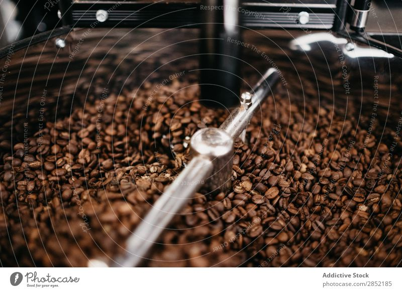 Close-up coffee grinding machine Coffee Grind Grinder Beans Espresso Brown Roasted Café Drinking Breakfast Caffeine Shopping Aromatic Dark Natural Professional