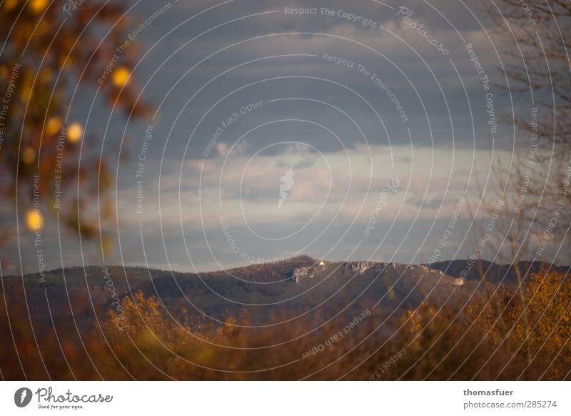 Sky Nature Vacation & Travel Tree Clouds Landscape Far-off places Environment Mountain Autumn Horizon Rock Brown Orange Gold Church