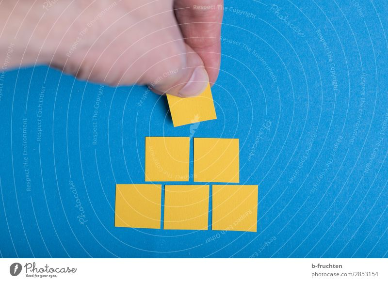 Building a pyramid Study Construction site Business Career Hand Fingers Paper Sign Select Utilize To hold on Simple Success Blue Yellow Quality Pyramid Brick