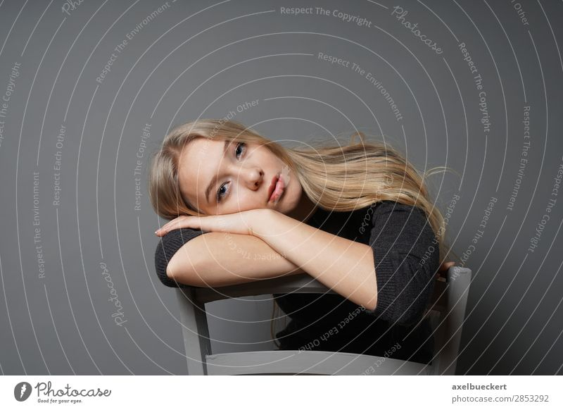 boredom Human being Feminine Young woman Youth (Young adults) Woman Adults 1 13 - 18 years 18 - 30 years Blonde Long-haired Sit Boredom Chair astride Inverted