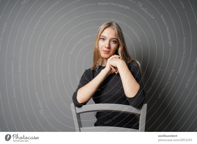 young woman sitting astride chair Human being Feminine Young woman Youth (Young adults) Woman Adults 1 13 - 18 years 18 - 30 years Blonde Long-haired Sit