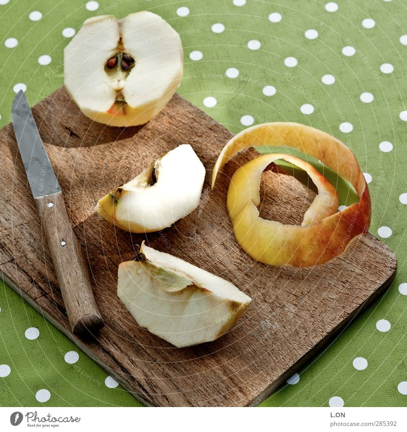 apple pieces Food Fruit Apple Nutrition Breakfast Picnic Organic produce Vegetarian diet Diet Fasting Knives Chopping board Table decoration Wood Eating Fresh