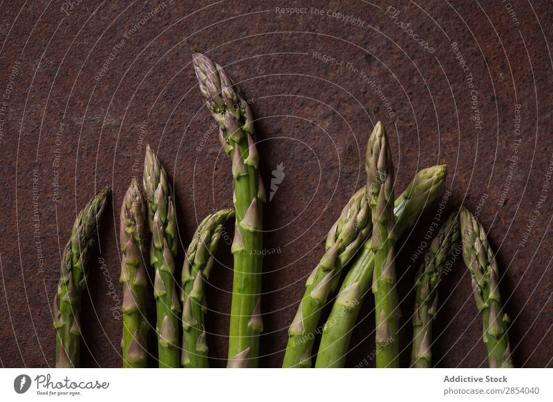 Green asparagus on dark metal background Arranged Asparagus bio bunch Dark Diet Food Fresh Gourmet Healthy Metal Natural Organic Raw Simple Tasty Vegan diet