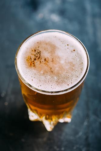 Glass of beer on dark background Alcoholic drinks ale Bar Beer Beverage Bottle Brewery Cool (slang) Craft (trade) Drinking Foam Food Gold Grunge Pub Table