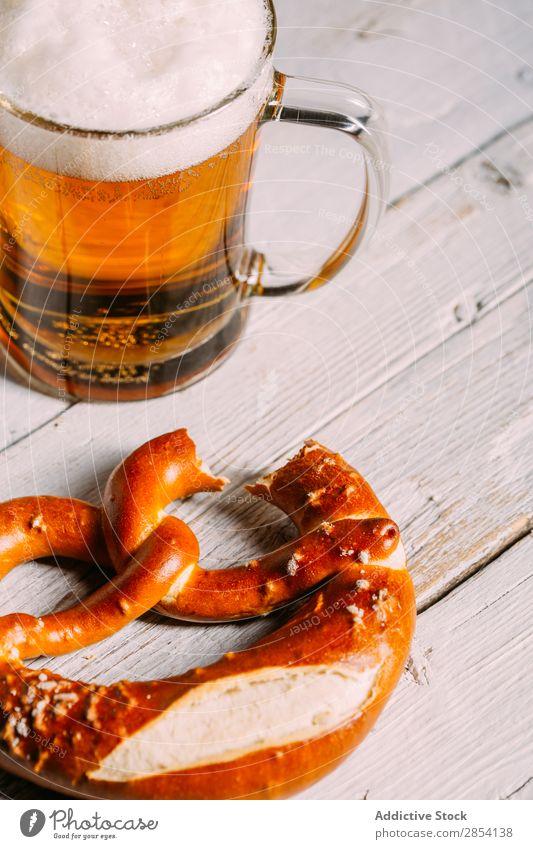 Beer jar and pretzel Bar Beverage Cool (slang) Drinking Foam Food Glass Gold Mug Oktoberfest Pretzel Rustic Salt Snack Table Thirsty Vintage Wood