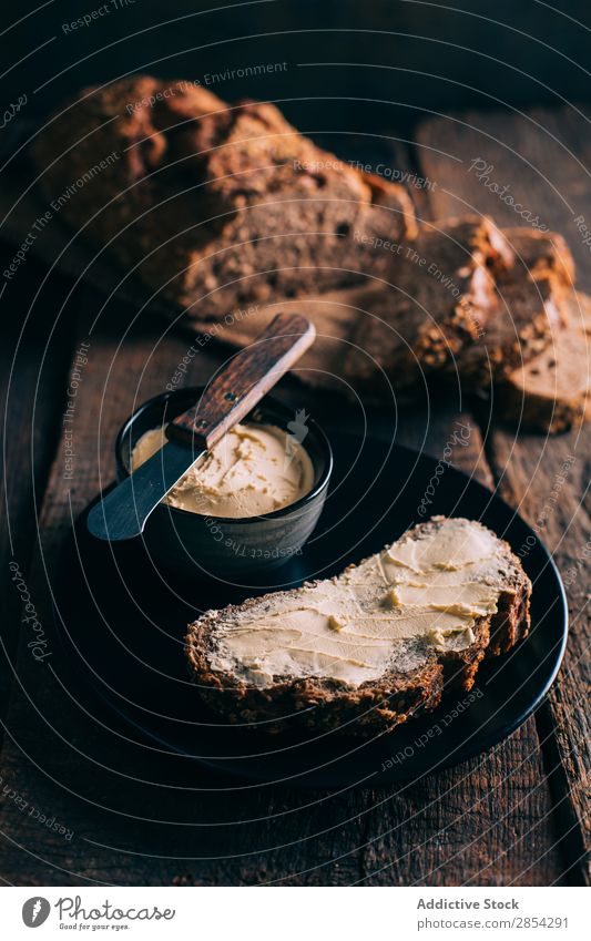 Rustic bread with butter Baking Bakery Bread Butter carbohydrate Dark Flour Food Fresh home-baked loaf Moody Spread Wheat Wood