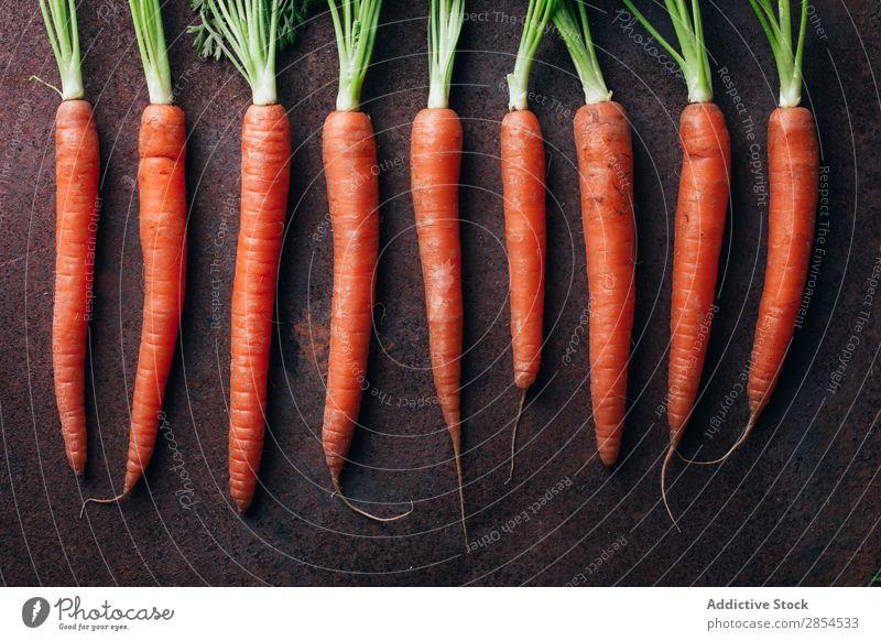 Bunch of fresh carrots in dark metallic background Background picture Carrot Multicoloured Dark Food Fresh Harvest Healthy Metal Nutrition Orange Organic Raw