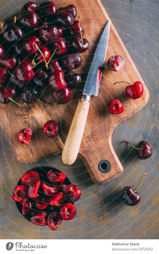 Cherries in a wooden cutting board black cherry Bowl Cherry Chopping board Delicious Dessert Food Fresh Fruit Healthy Juicy Knives Organic Raw Red Spring Sweet