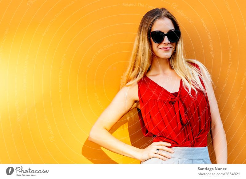 Portrait of beautiful woman looking at camera. Copy Space. Woman Wall (building) Beautiful Fashion Background picture Youth (Young adults) Model Style