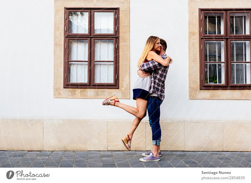 Young loving couple hugging in the street. Couple Love Woman Relationship Youth (Young adults) Beautiful Embrace Romance Joy Jump joying Happiness Kissing
