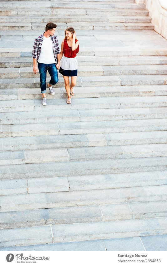 Romantic Young Couple Walking in the City. Relationship Love Youth (Young adults) Happy Laughter Smiling Human being Stairs Going Downward Summer Street Europe