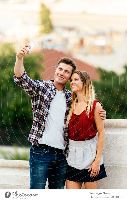 Romantic Young Couple taking a photo with mobile phone. Selfie Take Youth (Young adults) Telephone Photography Mobile Solar cell Self portrait Human being
