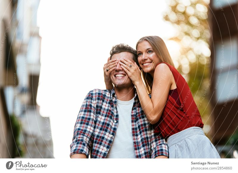 Young Couple having fun in the City. Love Woman Relationship Hand Eyes Youth (Young adults) Beautiful Friendship Surprise Romance Funny Jump joying Happiness