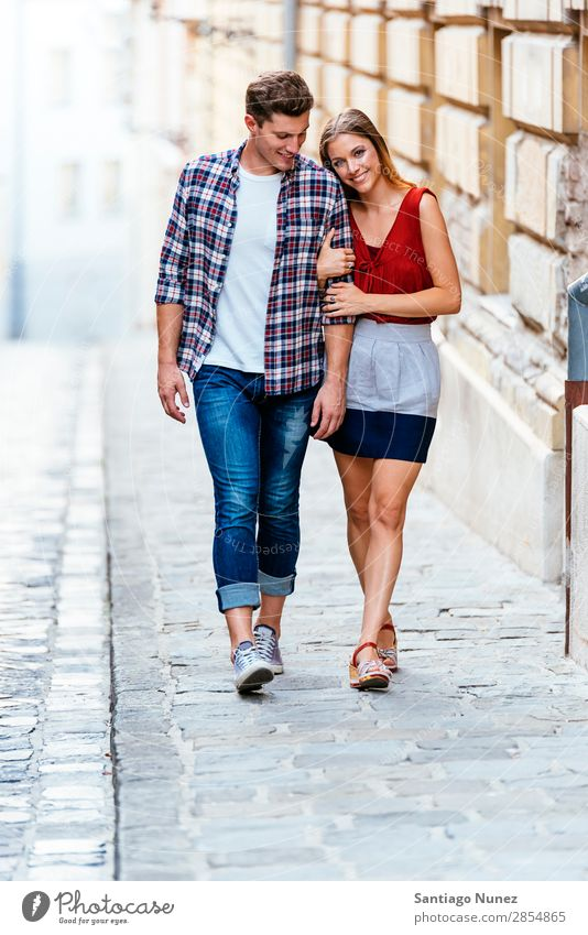 Romantic Young Couple Walking in the City. Relationship Love Youth (Young adults) Happy Laughter Smiling Human being Summer Street Europe Together Caucasian