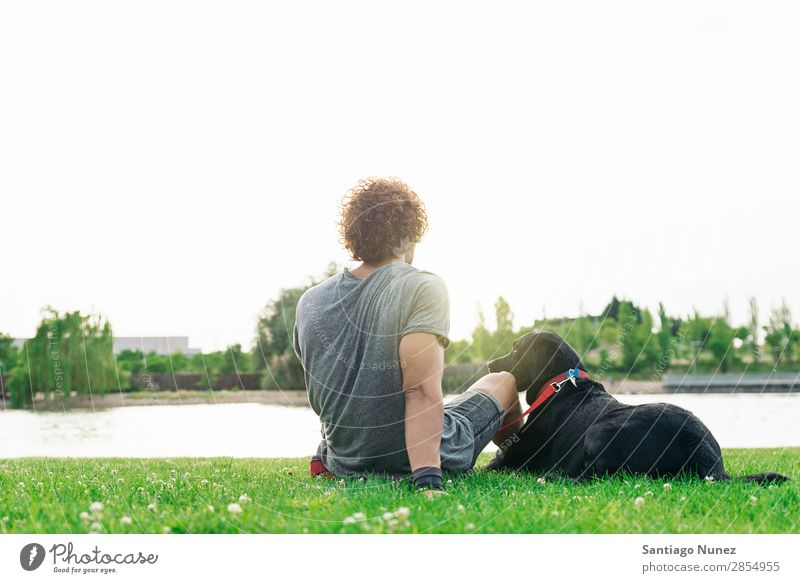 Man having fun with his dog. Dog Pet Park owner Human being Green Leash Walking Animal petting Happy Lifestyle Adults Guy Sky Summer Caucasian Joy Grass