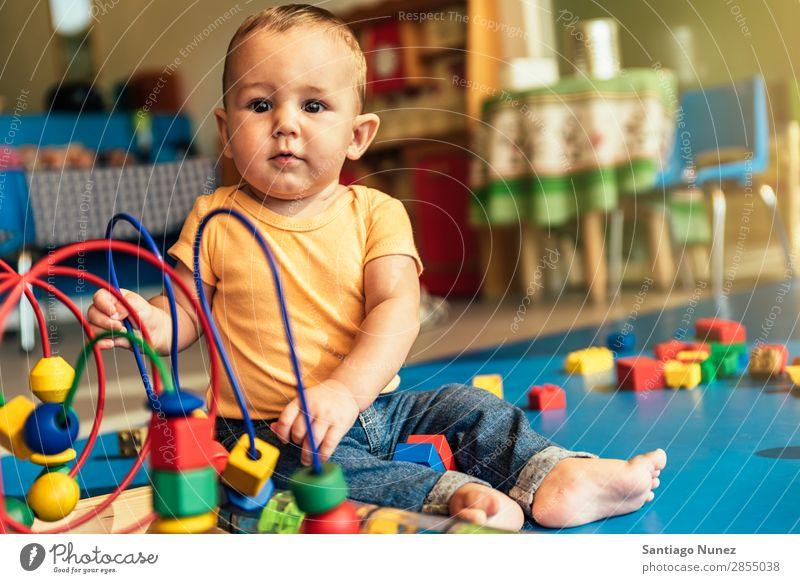 Happy baby playing with toy blocks. Baby Playing childcare Kindergarten School Toys Toddler Boy (child) Small Child LEGO Considerate Story Cute Joy Preschool