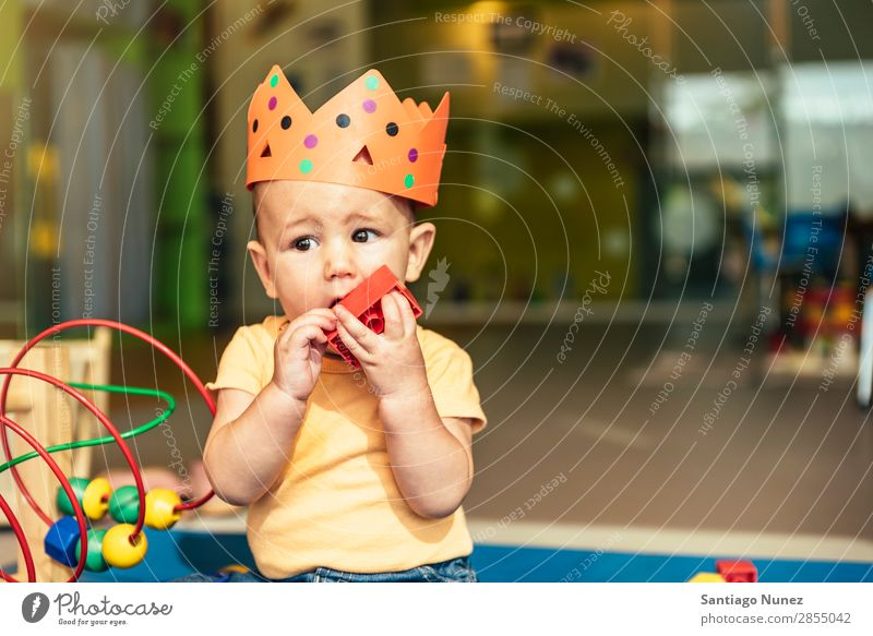Happy baby playing with toy blocks. Baby Playing childcare Kindergarten School Toys Crown King Bite Toddler Boy (child) Small Child Considerate Story