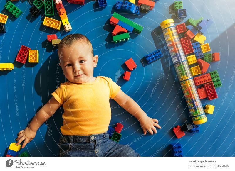 Happy baby playing with toy blocks. Baby Playing childcare Kindergarten School Toys Toddler Boy (child) Small Child Considerate Story Cute Joy Preschool