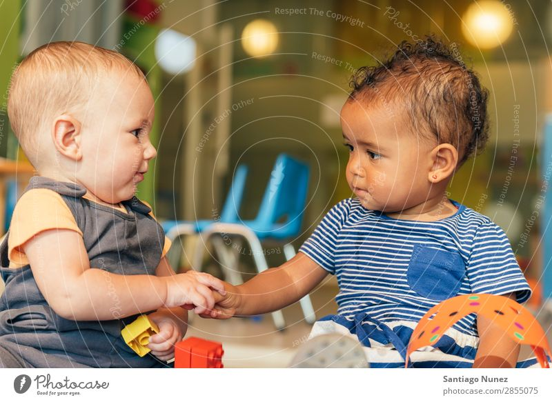 Babys playing together. Playing Child Kindergarten doing 2 Joy Boy (child) childcare Happy mulatta multiethnic Caucasian Home Infancy Lifestyle Human being Girl