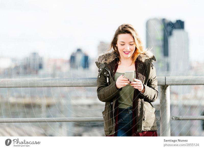 Happy girl texting on a smartphone. Telephone Mobile Woman Girl Human being PDA SMS