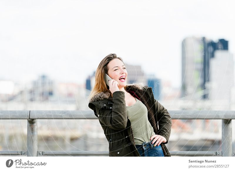 Beautiful woman at phone in the city. Telephone Woman City To talk Street Easygoing Mobile Youth (Young adults) Smart Background picture Happy speaking