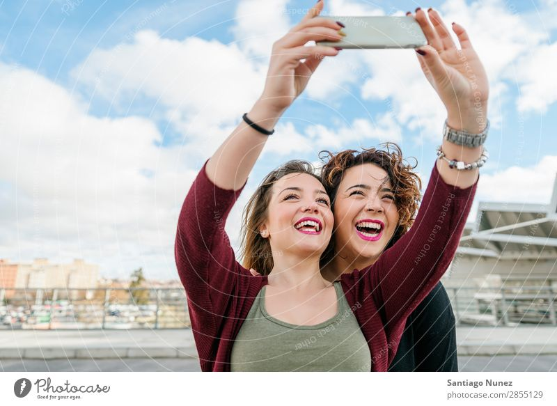 Two beautiful women taking selfiein the street. Selfie Laughter Happy Friendship girlfriends Youth (Young adults) Portrait photograph Summer Lifestyle Woman Joy