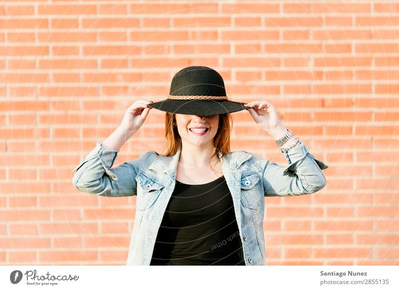 Blonde hipster posing with straw hat against orange brick background. Fashion Wall (building) Girl Hip & trendy Woman Youth (Young adults) Hipster Easygoing