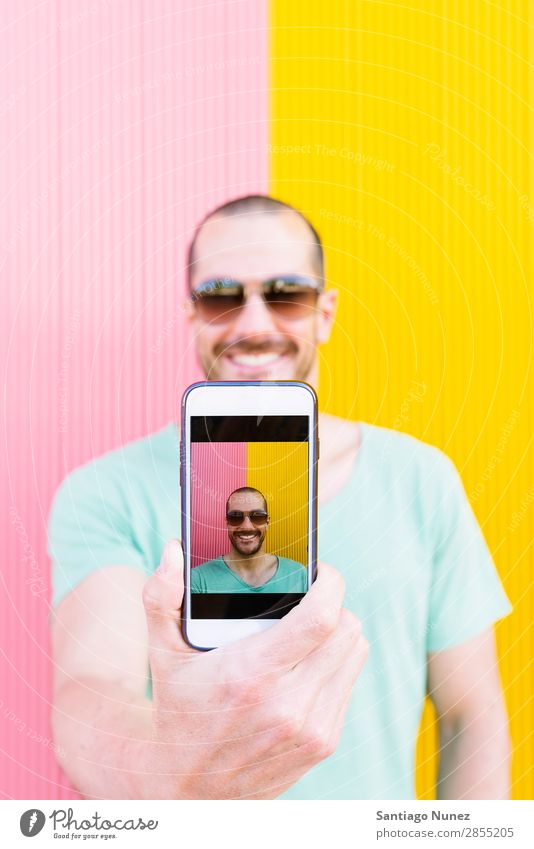Handsome Man Portrait taking selfie Selfie Human being Youth (Young adults) Telephone Take Lifestyle Happy Portrait photograph Modern City Exterior shot