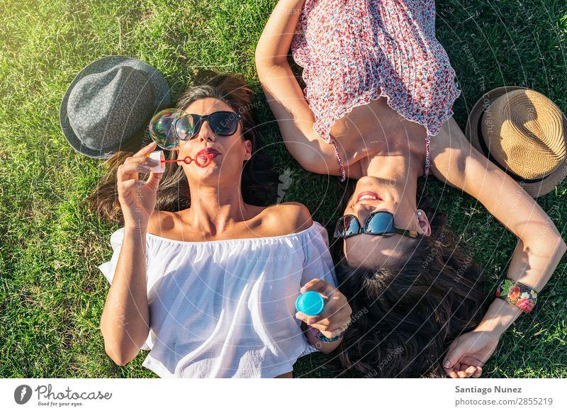 Joyful girls having fun in park. Friendship Woman Happy Balloon Happiness Air bubble Girl Soap