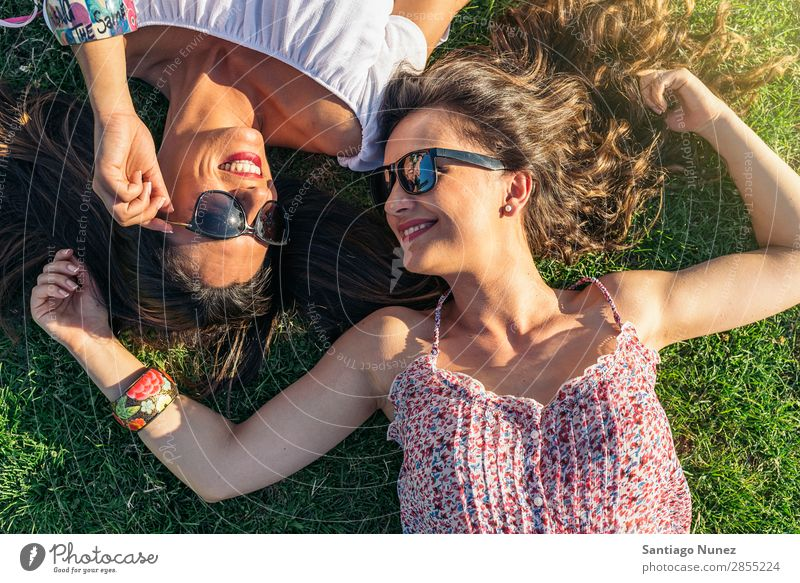 Joyful girls having fun in park. Friendship Woman Happy Lie (Untruth) Happiness Girl Beautiful
