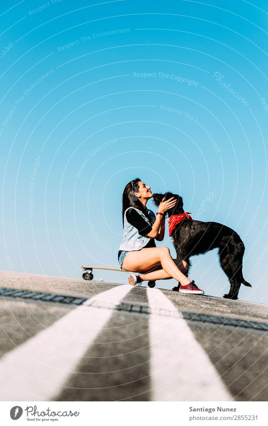 Beautiful young loving her dog. Girl Woman Dog Pet owner Ice-skating Town Youth (Young adults) Sports Skateboarding Longboard riding Ice-skates Happy Smiling