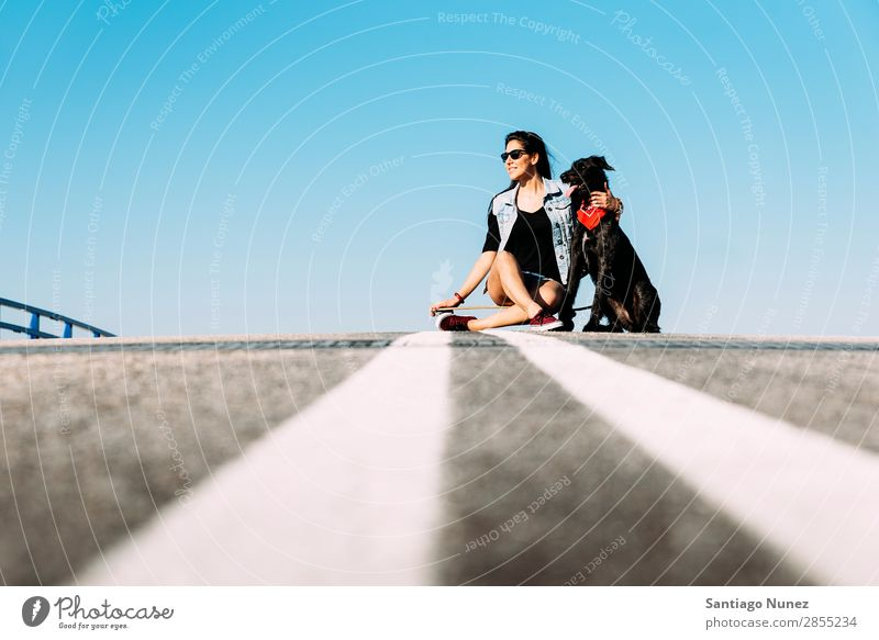 Beautiful young loving her dog. Girl Woman Dog Pet owner Ice-skating Town Youth (Young adults) Sports Longboard riding Ice-skates Happy Smiling Animal Puppy