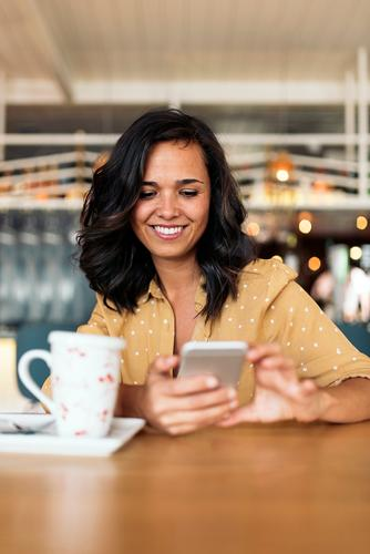 Portrait of beautiful woman using mobile. Woman Café Break Coffee Sit device Telephone Business 1 Beautiful pretty PDA Hold Mobile Smiling Lifestyle Human being