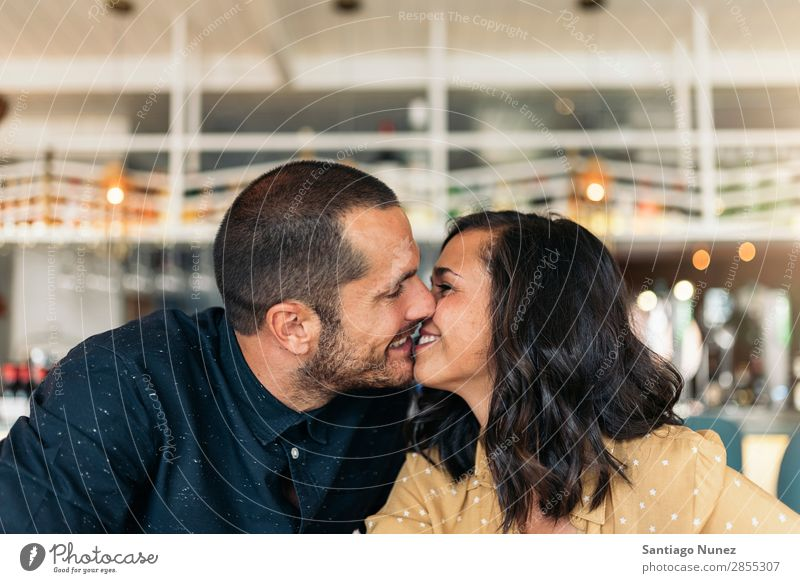 Smiling couple of lovers kissing. Love Kissing Couple Coffee Youth (Young adults) Beautiful Adults Woman Romance Man Sit To talk Easygoing romantic Embrace
