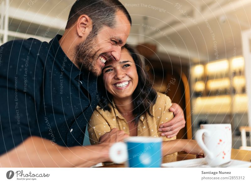 Smiling couple of lovers having fun. Love Embrace Couple Coffee Youth (Young adults) Beautiful Adults Woman Romance Man Sit To talk Easygoing romantic