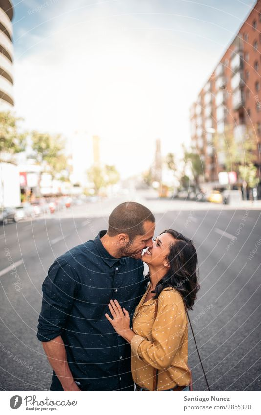 Smiling couple of lovers having fun. Woman Date Love Embrace Kissing Man Girl Youth (Young adults) Romance Couple City Happiness Happy Human being Together