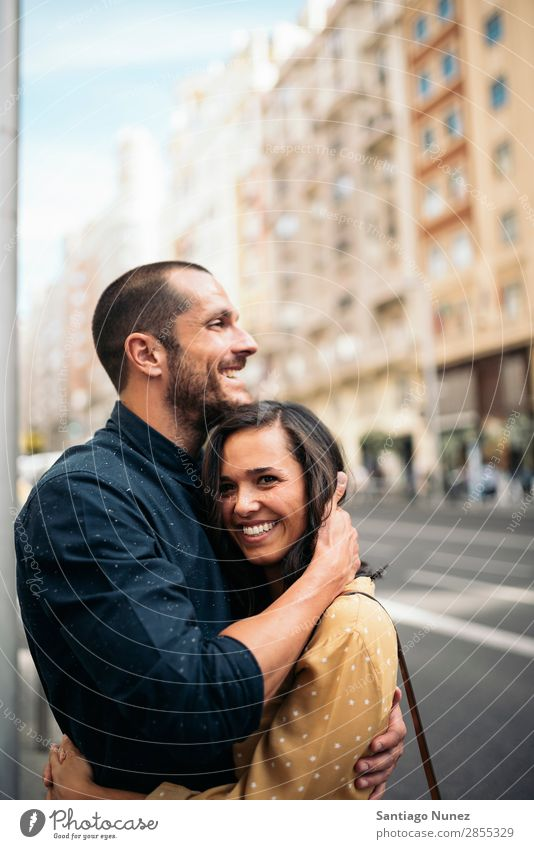 Smiling couple of lovers having fun. Woman Date Love Embrace Man Girl Youth (Young adults) Romance Couple City Happiness Happy Human being Together Street