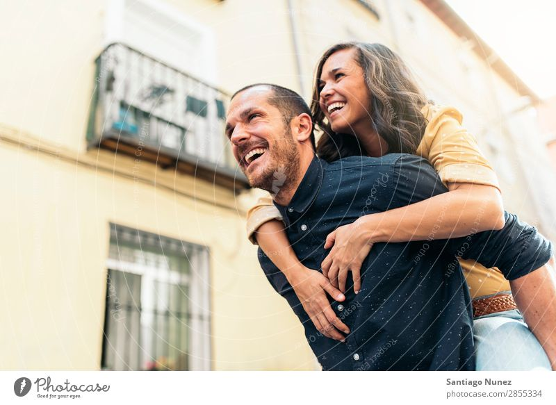 Smiling couple of lovers having fun. Couple Woman Date Love Embrace Man Girl Youth (Young adults) Romance City Happiness Happy Human being Together Street
