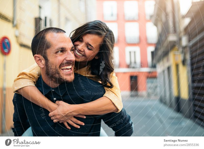 Smiling couple of lovers having fun. Couple Woman Date Love Embrace Man Girl Youth (Young adults)