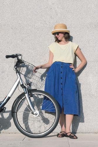 Young sexy blonde girl is standing near the bicycle Adults Background picture Bag Basket Beautiful Beauty Photography Bicycle Blonde Blue Brown Caucasian City