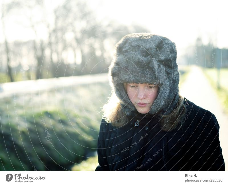 winter blues Human being Child Girl Life 1 8 - 13 years Infancy Winter Beautiful weather Tree Street Lanes & trails Jacket Cap Sadness Authentic Cold Natural