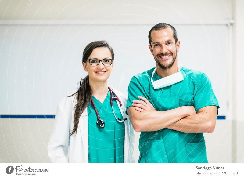 Smiling doctor and nurse portraiture clinic Self-confident coworker Doctor examining Woman Girl Hand Happy Healthy Health care Hospital Profession Laboratory