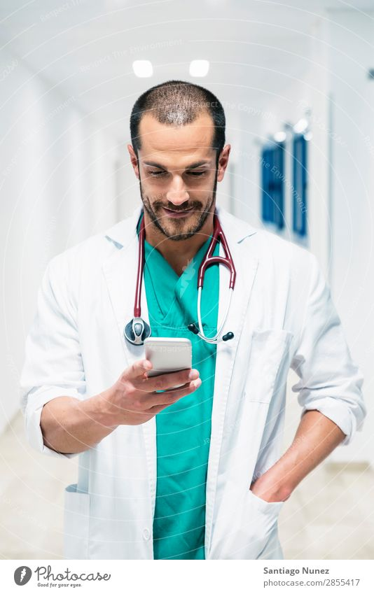 Beautiful doctor writting on cellphone at hospital Attractive Considerate Caucasian Cellphone Cheerful clinic clinician Communication Doctor Email Woman